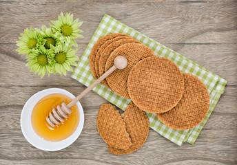 Dutch Waffles with honey on wooden background