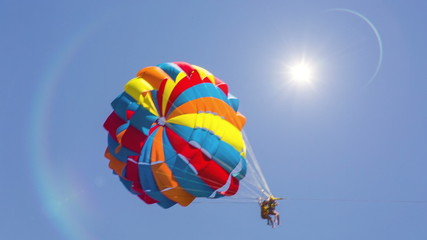 Parachute moving across the screen. Bright Sun. HD 1080.