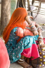 woman draped in colorful costume, Rajasthan, India