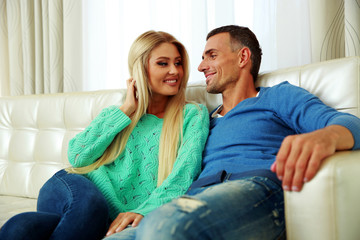 Happy young couple on a sofa at home