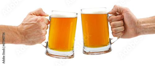 Fotobehang Bier cheers, two glass beer mugs isolated on white
