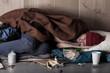 Poor man sleeping on the street