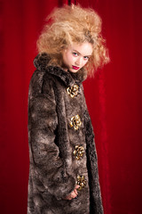 Beautiful blond woman in a fur