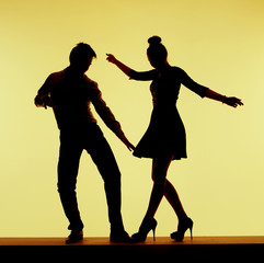 Two silhouettes on the dance-floor
