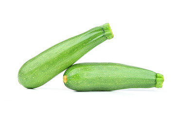 Pair of fresh green zucchini isolated on white background