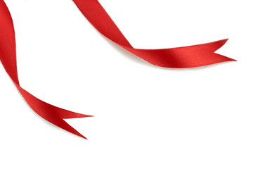 Red ribbons on white background.
