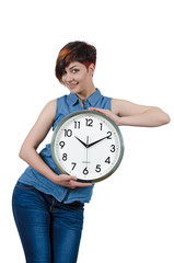 Young girl holding a large wall clock. Isolated on white