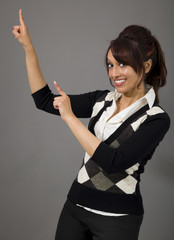 Indian businesswoman pointing and smiling