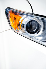 Headlight on modern white vehicle