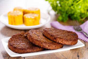 Beefsteak with corncob - Frikadelle mit Maiskolben