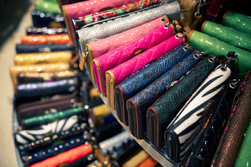wallets on shelf in clothes shop