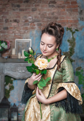Beautiful woman in medieval dress with flower