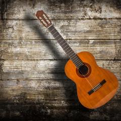 chitarra acustica in fondo legno