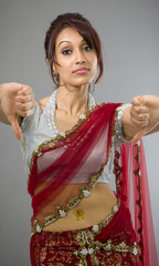 Young Indian woman showing thumbs down sign from both hands