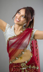 Young Indian woman dancing and smiling