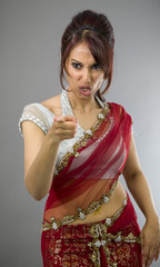 Young Indian woman scolding somebody