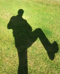 Shadow of man on grass