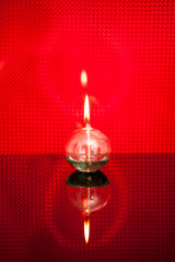 Alcohol lamp lighting on red background