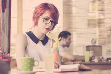 Cute hipster girl studying. Retro tones
