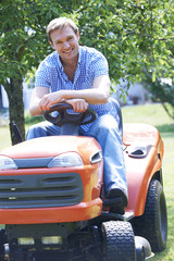 Man Cutting Grass Using Sit On Mower