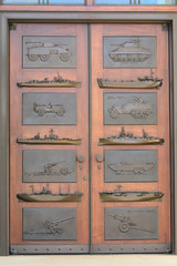 US Military cemetery chapel door brass boats tanks guns