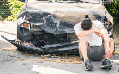 Desperate man crying on his old damaged car - Crash accident