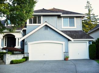 Fresh paint and stain job on exterior of modern home