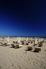 Italy, Sicily, deck chairs and beach umbrellas on the beach