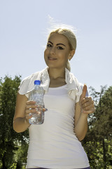 fitness girl holding bottle of water