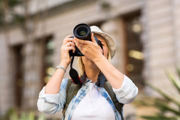 tourist taking photo in city