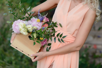 tender girl in a dress holding a beautiful bouquet of flowers