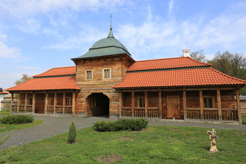 Ukrainian wooden house wuth red tile roof