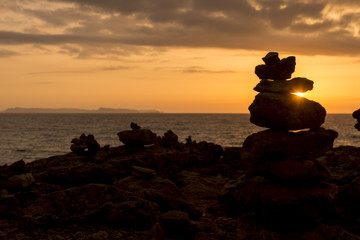 Stones in the beach at sunset in south of Mallorca