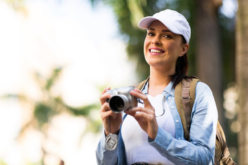 young female tourist holding a camera