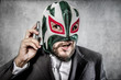 Trouble, aggressive executive suit and tie, Mexican wrestler mas