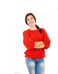 Attractive young girl in Red pullover and blue jeans thinking ab