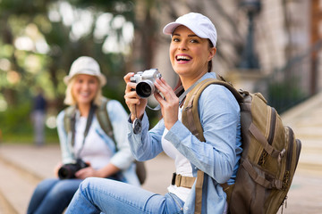 cheerful tourist holding a camera
