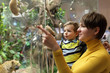 Mother and son looking at wild animals