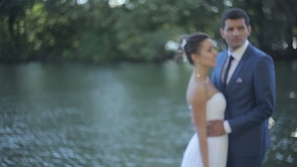 bride and groom near the water