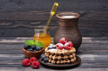 Waffles with berries, honey and milk. Healthy Breakfast
