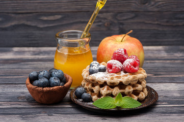 Waffles with berries, fruit and honey. breakfast