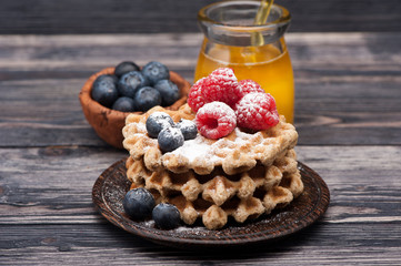 Waffles with berries and honey. Breakfast