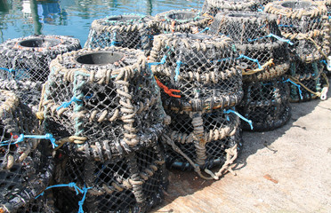 A Stack of Fishing Pots on a Harbour Wall.