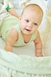 happy baby in crib