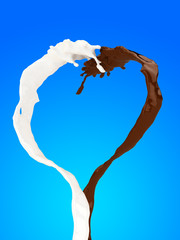 Heart of chocolate and milk splash on blue background