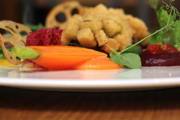 Rim of plate with small carrot