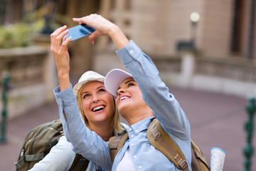 friends taking self portrait at tourist's attraction