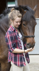 Young rider with her pony
