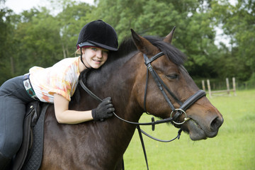 Portrait of a young rider with her pony