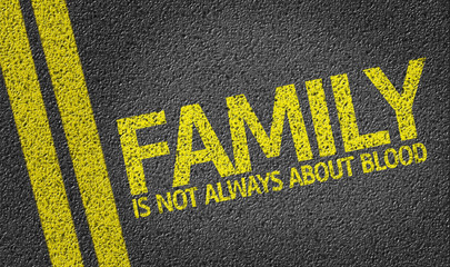 Family Is Not Always About Blood written on the road